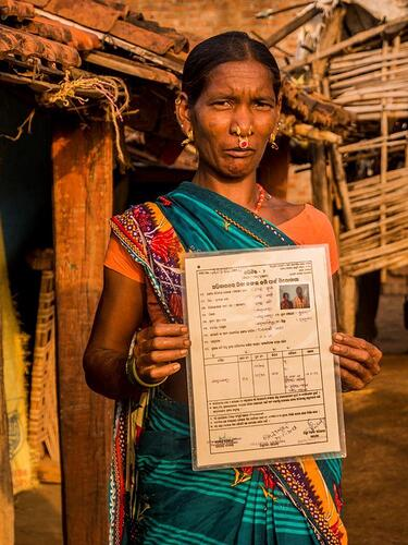 Women showing her joint title of land rights-3