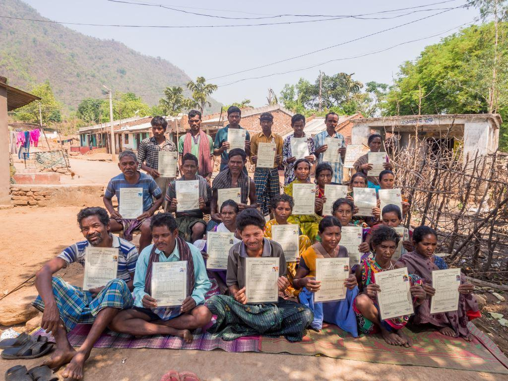 Poduchan-Villagers-showing-land-right-title-received-2